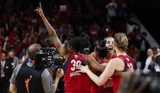 Washington Mystics forward LaToya Sanders (30), forward Elena Delle Donne (11), center Emma Meesseman (33) and others celebrate after Game 5 of basketball's WNBA Finals against the Connecticut Sun, Thursday, Oct. 10, 2019 in Washington. (AP Photo/Alex Brandon)