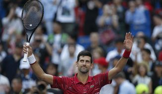 Novak Djokovic of Serbia celebrates after defeating John Isner of the United States in their men's singles match at the Shanghai Masters tennis tournament at Qizhong Forest Sports City Tennis Center in Shanghai, China, Thursday, Oct. 10, 2019. (AP Photo/Andy Wong)
