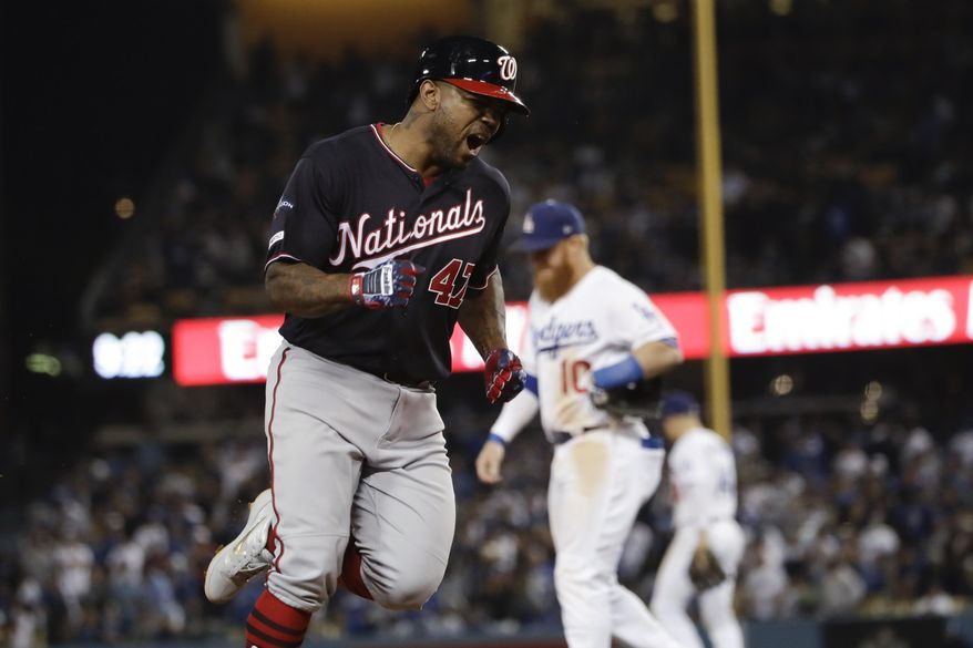 Washington Nationals' Howie Kendrick celebrates after a grand slam against the Los Angeles Dodgers during the 10th inning in Game 5 of a baseball National League Division Series on Wednesday, Oct. 9, 2019, in Los Angeles. (AP Photo/Marcio Jose Sanchez) ** FILE **