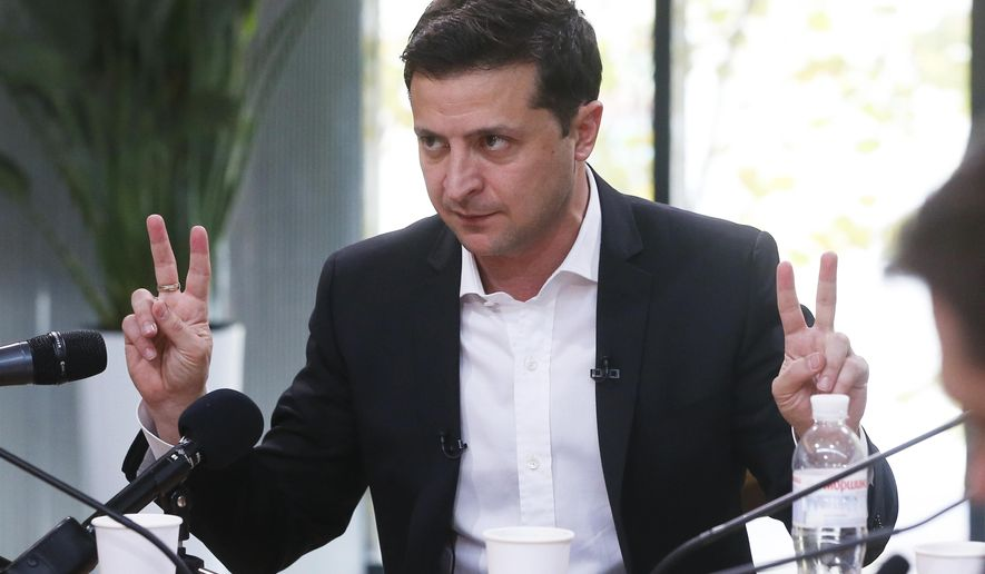 """Ukrainian President Volodymyr Zelenskiy speaks during talks with journalists in Kyiv, Ukraine, Thursday, Oct. 10, 2019. Ukrainian President is holding an all-day """"media marathon"""" in a Kyiv food court amid growing questions about his actions as president. (AP Photo/Efrem Lukatsky)"""