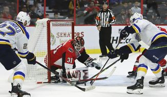 St. Louis Blues' Alex Pietrangelo (27) and teammate Tyler Bozak (21) attempt to get the puck past Ottawa Senators goaltender Anders Nilsson (31) during second-period NHL hockey game action in Ottawa, Ontario, Thursday, Oct. 10 2019. (Fred Chartrand/The Canadian Press via AP)