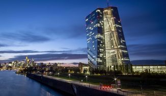 The European Central Bank is seen next to the river Main in Frankfurt, Germany, late Wednesday, Oct. 2, 2019. (AP Photo/Michael Probst)