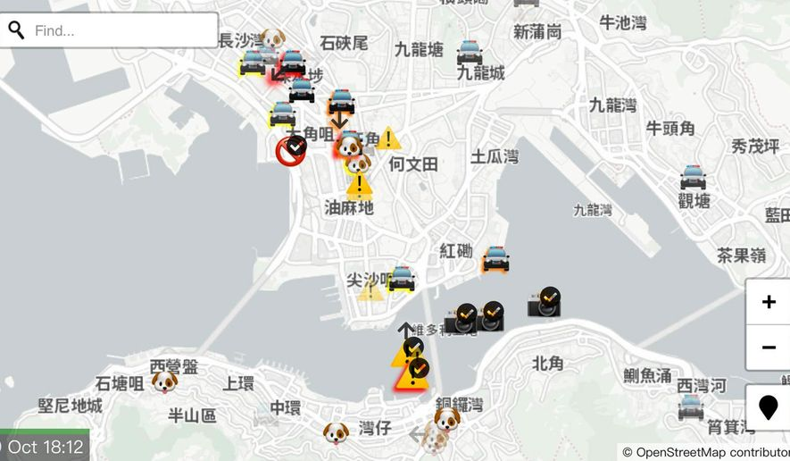 """A display of the app """"HKmap.live"""" designed by an outside supplier and available on Apple Inc.'s online store is seen in Hong Kong Wednesday, Oct. 9, 2019. Apple became the latest company targeted for Chinese pressure over protests in Hong Kong when the ruling Communist Party's main newspaper criticized the tech giant Wednesday for a smartphone app that allows activists to report police movements. HKmap.live, designed by an outside supplier and available on Apple Inc.'s online store, """"facilitates illegal behavior,"""" People's Daily said in a commentary. (AP Photo/Vincent Yu)"""