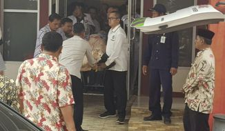 Indonesian medics wheel Indonesian Coordinating Minister for Politics, Law and Security Wiranto on a stretcher to an ambulance to be evacuated to Jakarta, at a hospital in Pandeglang, Banten province, Indonesia, Thursday, Oct. 10, 2019. Police say a knife-wielding man has wounded the top security minister, a local police chief and another person in a western province. (AP Photo)