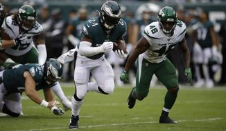 Philadelphia Eagles' Jordan Howard rushes during the first half of an NFL football game against the New York Jets, Sunday, Oct. 6, 2019, in Philadelphia. (AP Photo/Matt Rourke)