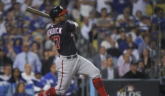 Washington Nationals' Howie Kendrick watches his grand slam against the Los Angeles Dodgers during the 10th inning in Game 5 of a baseball National League Division Series on Wednesday, Oct. 9, 2019, in Los Angeles. (AP Photo/Mark J. Terrill) ** FILE **
