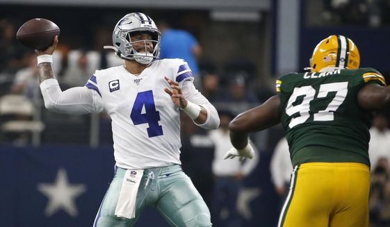 Dallas Cowboys quarterback Dak Prescott (4) throws a pass under pressure from Green Bay Packers' Kenny Clark (97) in the first half of an NFL football game in Arlington, Texas, Sunday, Oct. 6, 2019. The pass was intercepted by Chandon Sullivan. (AP Photo/Ron Jenkins)