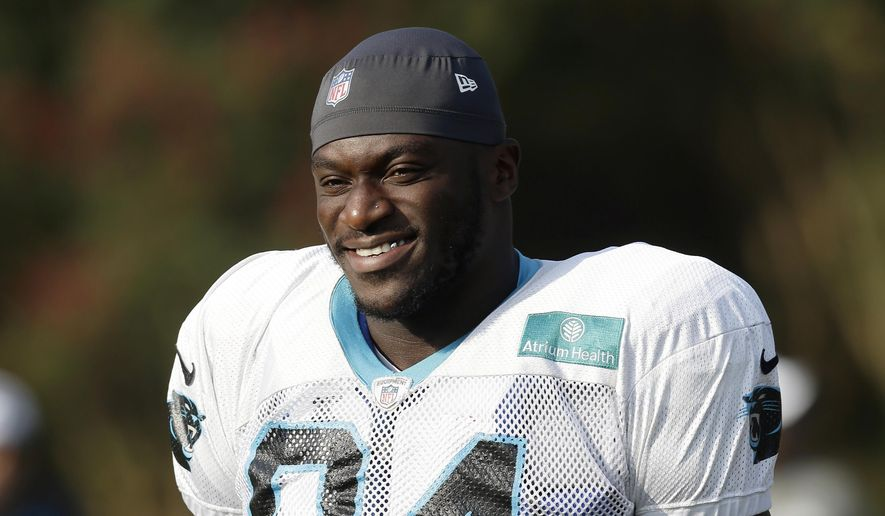 FILE - In this Aug. 13, 2019, file photo, Carolina Panthers' Efe Obada (94) takes the field during an NFL football training camp in Spartanburg, S.C. For Panthers defensive end Efe Obada the game Sunday between Carolina (3-2) and the Bucs (2-3) is a homecoming. The Nigerian native who arrived in England as a 10-year-old after being trafficked with his sister from the Netherlands, comes back to London as an NFL player and a star attraction after first picking up the sport of American football at age 22. (AP Photo/Gerry Broome, File)