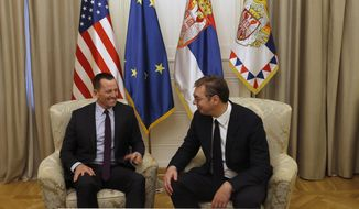U.S President Donald Trump's envoy for the Kosovo-Serbia dialogue, Ambassador Richard Grenell, left, speaks with Serbian President Aleksandar Vucic during a meeting in Belgrade, Serbia, Thursday, Oct. 10, 2019. Grenell is meeting officials in Belgrade as part of a renewed effort to restart negotiations and resolve decades-long disputes between former war foes. (AP Photo/Darko Vojinovic)