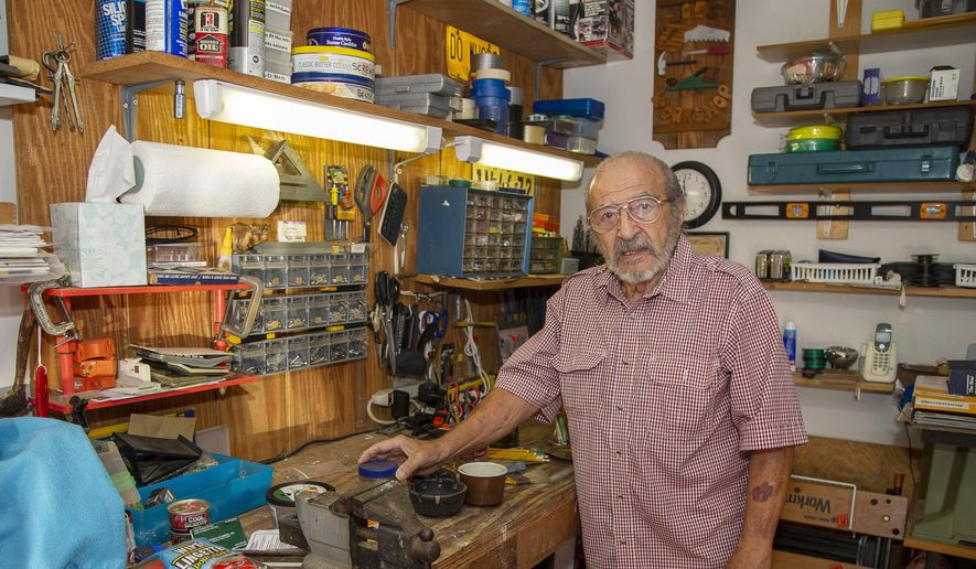 In this Oct. 9, 2019, photo, Joe Schiavone, 81, stands in his workshop in West Melbourne, Fla. Schiavone will get a modest cost-of-living increase from Social Security for 2020, a political year in which many Democrats are calling for a boost in basic benefits and a more generous formula to compute annual inflation adjustments. (AP Photo/Mike Brown)