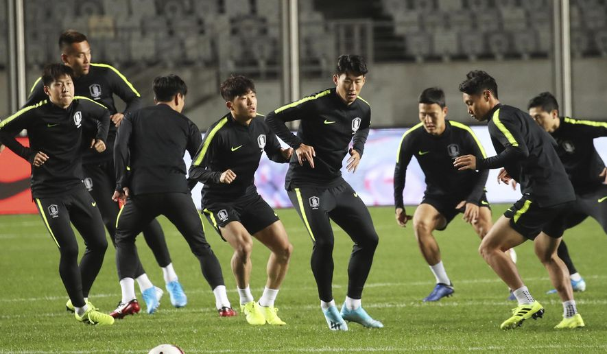 In this Wednesday, Oct. 9, 2019, photo, South Korea national soccer team's Son Heung-min, center, warms up during a training session ahead of Asian zone Group H qualifying soccer match against Sri Lanka for the 2022 World Cup at Hwaseong Sports Complex Main Stadium in Hwaseong, South Korea. (Hong Ki-won/Yonhap via AP)