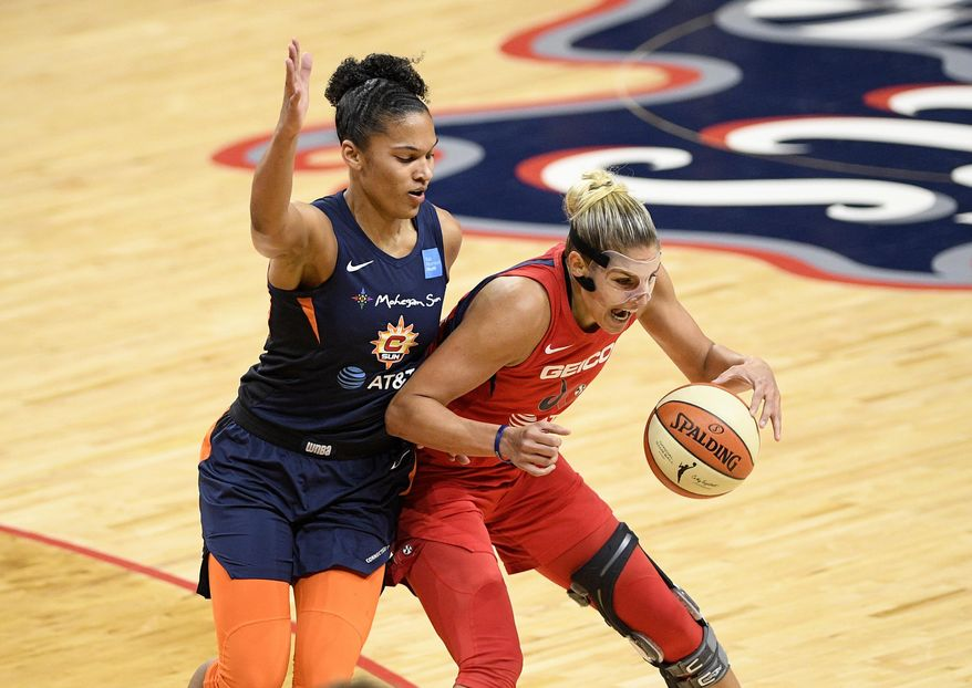 Washington Mystics forward Elena Delle Donne, right, dribbles the ball next to Connecticut Sun forward Alyssa Thomas, left, during the first half of Game 5 of basketball's WNBA Finals, Thursday, Oct. 10, 2019, in Washington. (AP Photo/Nick Wass) ** FILE **
