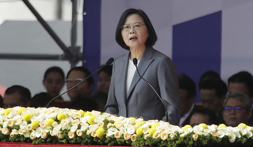 "Taiwan President Tsai Ing-wen delivers a speech during National Day celebrations in front of the Presidential Building in Taipei, Taiwan, Thursday, Oct. 10, 2019. In the national day address, President Tsai said China was threatening the island ""nonstop"" and posing a major challenge to regional peace and stability. (AP Photo/Chiang Ying-ying)"
