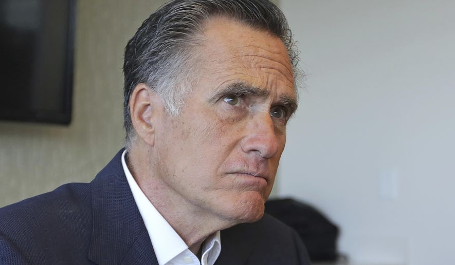 Sen. Mitt Romney, R-Utah, listens to reporters following a roundtable discussion at Intermountain Primary Children's Hospital with officials and health experts to receive an update on anti-vaping efforts Thursday, Oct. 10, 2019, in Salt Lake City. (AP Photo/Rick Bowmer) ** FILE **
