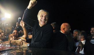 Tunisian presidential candidate and media mogul Nabil Karoui, waves as he is greeted by jubilant crowds after he was released from prison in Mannouba, Tunisia, Wednesday Oct. 9, 2019, just four days before the upcoming presidential runoff election. Karoui has been jailed since August under investigation for alleged money laundering and tax fraud that he asserts as a politically motivated smear campaign. (AP Photo)