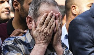 A mourner cries during the funeral of ten-month-old Mohammed Omar Saar, killed during incoming shelling from Syria Thursday, in Akcakale, Sanliurfa province, southeastern Turkey, at the border with Syria, Friday, Oct. 11, 2019. (AP Photo/Emrah Gurel)
