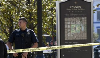 Police gather near the Capitol South Station Metro stop near Capitol Hill in Washington, Friday, Oct. 11, 2019. (AP Photo/Susan Walsh)