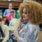 FILE - In this May 13, 2017, file photo, Lil Miss Hot Mess reads to children during the Feminist Press' presentation of Drag Queen Story Hour at the Park Slope Branch of the Brooklyn Public Library, in New York. Residents are defending a Louisiana public library's plan to host fraternity brothers who are going to read to young children while dressed as drag queens. Similar events have been held in Atlanta, New York City and Orlando, Fla. (AP Photo/Mary Altaffer, File)