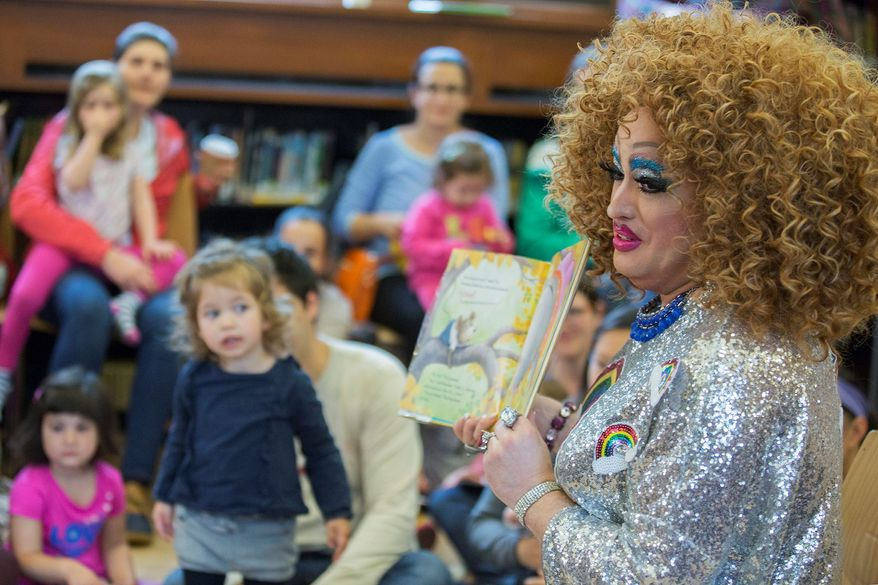 In this May 13, 2017, file photo, Lil Miss Hot Mess reads to children during the Feminist Press' presentation of Drag Queen Story Hour at the Park Slope Branch of the Brooklyn Public Library, in New York. Residents are defending a Louisiana public library's plan to host fraternity brothers who are going to read to young children while dressed as drag queens. Similar events have been held in Atlanta, New York City and Orlando, Fla. (AP Photo/Mary Altaffer, File)