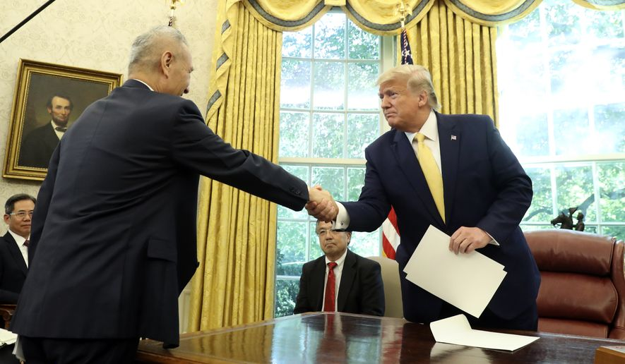 President Donald Trump shakes hands with Vice Premier Liu He in the Oval Office of the White House in Washington, Friday, Oct. 11, 2019. (AP Photo/Andrew Harnik)