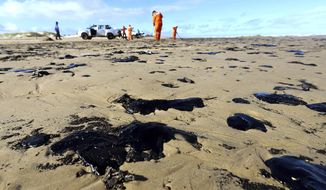 "CORRECTS DATE - In this Oct. 7, 2019 handout photo released by the Aracaju Municipal Press Office, workers remove oil from Viral Beach, in Aracaju, Brazil. The oil that has been polluting Brazil's northeastern beaches since early September is likely coming from Venezuela, according to a report by Brazil's state oil company cited by the country's environment minister. The oil sludge has now reached 61 municipalities in nine Brazilian states, contaminating over 130 beaches, in what Brazilian officials have called an ""unheard of"" disaster. (Andre Moreira/Aracaju Municipal Press Office via AP)"