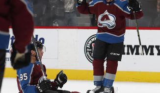 Colorado Avalanche left wing Andre Burakovsky, left, celebrates his go-ahead goal with defenseman Samuel Girard during the third period of the team's NHL hockey game against the Boston Bruins on Thursday, Oct. 10, 2019, in Denver. (AP Photo/David Zalubowski)