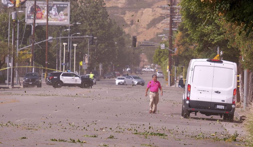 Strong Santa Ana winds in Chatsworth, Calif., blew across power lines causing them to arc and transformers to explode. Power was out for street signs, businesses and residents along Devonshire St. from Topanga Canyon Blvd. to Variel Ave. on Thursday, Oct. 10, 2019. (Dean Musgrove/The Orange County Register via AP)