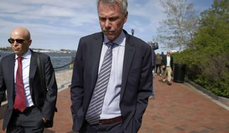 FILE - In this May 22, 2019 file photo, Jan Sartorio leaves federal court in Boston after pleading guilty to charges in a nationwide college admissions bribery scandal. Sartorio was sentenced on Friday, Oct. 11, to one year of probation. (AP Photo/Michael Dwyer, File)