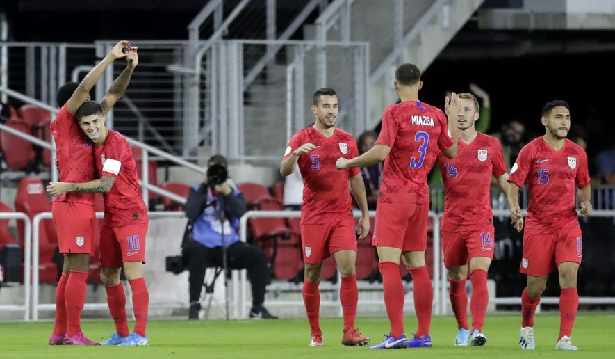 United States' Weston McKennie, left, is congratulated by Christian Pulisic (10) after scoring a goal on Cuba in the first minute of the first half of a CONCACAF Nations League soccer match Friday, Oct. 11, 2019, in Washington. (AP Photo/Julio Cortez)