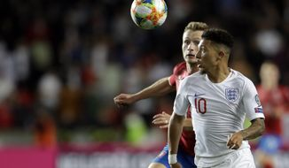 England's Jadon Sancho, front, and Czech Republic's Jakub Brabec run for the ball during the Euro 2020 group A qualifying soccer match between Czech Republic and England at the Sinobo stadium in Prague, Czech Republic, Friday, Oct. 11, 2019. (AP Photo/Petr David Josek)