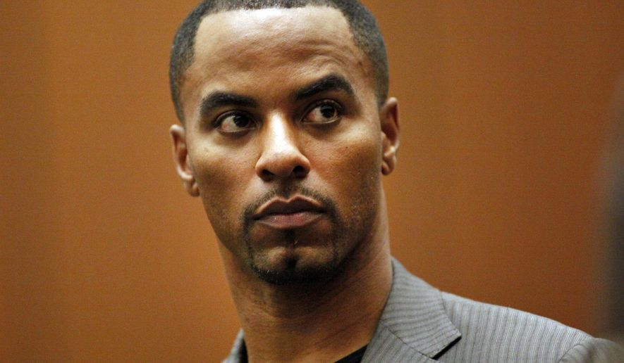 FILE - In this Feb. 20, 2014, file photo, former NFL safety Darren Sharper appears in Los Angeles Superior Court in Los Angeles. Imprisoned former NFL star Darren Sharper is pressing on with his attempts to reduce his 18-year federal sentence in a sexual assault case.  An on-again-off-again appeal was revived Friday, Oct. 11, 2019, at the 5th U.S. Circuit Court of Appeals in New Orleans. (Bob Chamberlin/Los Angeles Times via AP, Pool, File)