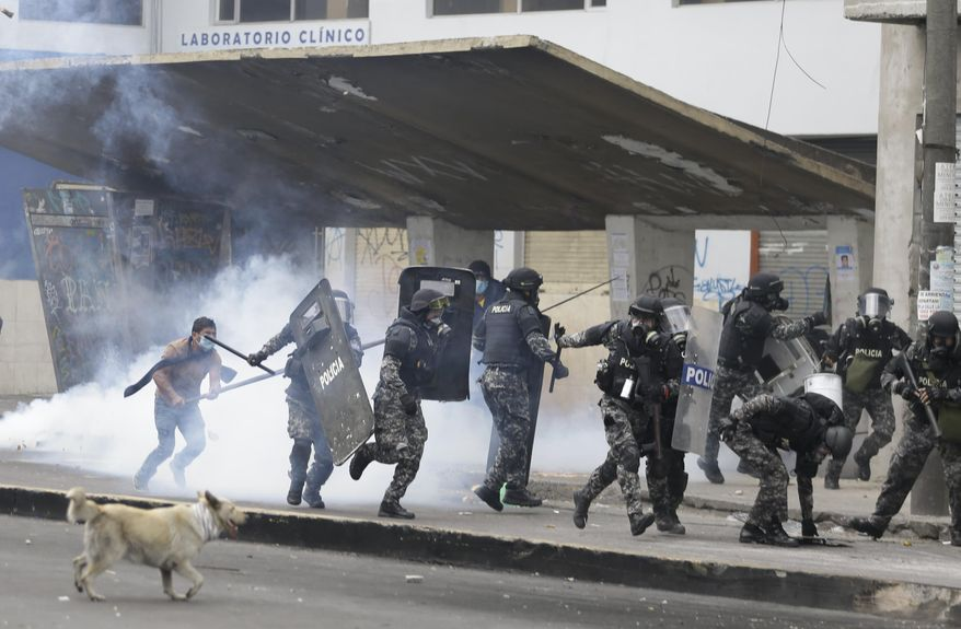 Anti-government demonstrators clash with police in Quito, Ecuador, Friday, Oct. 11, 2019. Protests started last week after Ecuador's President Lenin Moreno ended fuel subsidies. The disturbances have spread from transport workers to students and then to indigenous demonstrators. (AP Photo/Fernando Vergara)