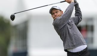 Peter Malnati tees off on the 17th hole during the Houston Open golf tournament at the Golf Club of Houston in Humble, Texas, Friday, Oct. 11, 2019. (Wilf Thorne/Houston Chronicle via AP)