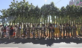 Police personnel stand in the shade of banana trees at the entrance at the entrance to Mamallapuram, where Indian Prime Minister Narendra Modi and Chinese President Xi Jinping will hold their first meeting and dinner in southern India, Friday, Oct. 11, 2019. Xi is coming to India to meet with Modi on Friday, just weeks after Beijing supported India's rival Pakistan in raising the issue of New Delhi's recent actions in disputed Kashmir at the U.N. General Assembly meeting. (AP Photo/Manish Swarup)