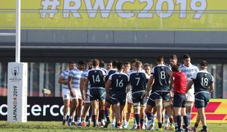 United States and Argentina players shake hands following their Rugby World Cup Pool C game at Kumagaya Rugby Stadium in Kumagaya City, Japan, Wednesday, Oct. 9, 2019. (AP Photo/Eugene Hoshiko)