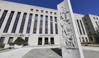 A view of the E. Barrett Prettyman Courthouse in Washington, Friday, Oct. 11, 2019. A U.S. appeals court is voicing broad skepticism about the Trump administration's work requirements for low-income Medicaid recipients. (AP Photo/Susan Walsh)
