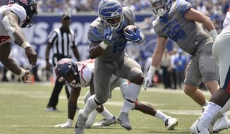 FILE - In this Aug. 31, 2019, file photo, Memphis running back Kenneth Gainwell (19) carries the ball in the first half of an NCAA college football game against Mississippi, in Memphis, Tenn. Gainwell has run for 620 yards and averages 124 yards rushing per game to rank sixth among all Football Bowl Subdivision players. Memphis takes on Temple in Philadelphia on Saturday. Temple ranks second among all FBS teams in red-zone defense and fourth in third-down conversion percentage defense. (AP Photo/Brandon Dill, File)