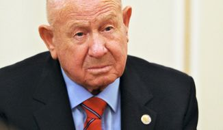 FILE - In this Friday, June 14, 2013 file photo, Russian cosmonaut Alexei Leonov, who made the first spacewalk in 1965, attends a meeting with Russian President Vladimir Putin in the Novo-Ogaryovo residence outside Moscow, Russia. Alexei Leonov, the first human to walk in space, died in Moscow on Friday, Oct. 11, 2019. He was 85 (Mikhail Klimentyev, Sputnik, Kremlin Pool Photo via AP, File)