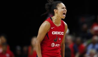 Washington Mystics guard Kristi Toliver reacts during the second half of Game 5 of basketball's WNBA Finals against the Connecticut Sun, Thursday, Oct. 10, 2019, in Washington. (AP Photo/Alex Brandon)