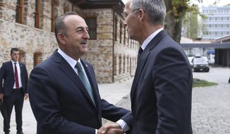 Turkish Foreign Minister Mevlut Cavusoglu, left, welcomes NATO Secretary General Jens Stoltenberg before a meeting in Istanbul, Friday, Oct. 11, 2019. (Turkish Foreign Ministry via AP, Pool)