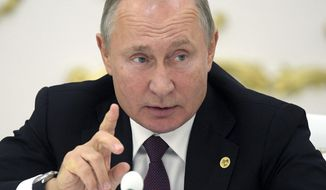 Russian President Vladimir Putin gestures while speaking at the Summit of leaders from the Commonwealth of Independent States (CIS) in Ashgabat, Turkmenistan, Friday, Oct. 11, 2019. Putin says he is worried that the Turkish invasion in Syria could pose a threat of a terrorist revival in the region. (Alexei Druzhinin, Sputnik, Kremlin Pool Photo via AP)