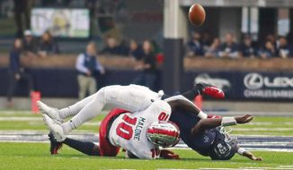 Old Dominion quarterback Stone Smartt is sacked Western Kentucky's DeAngelo Malone (10) during the first half of an NCAA college football game, Saturday, Oct. 5, 2019 in Norfolk, Va. (L. Todd Spencer/The Virginian-Pilot via AP)