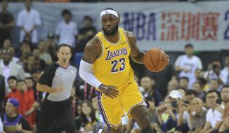 Los Angeles Lakers' LeBron James in action during a match against Brooklyn Nets at the NBA China Games 2019 in Shenzhen in south China's Guangdong province on Saturday, Oct. 12, 2019 (Color China Photo via AP) **FILE**