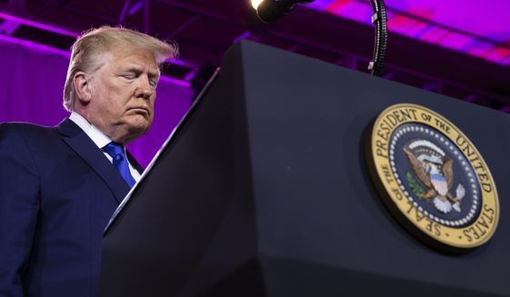 President Donald Trump bows his head down as they say their prayer at the Values Voter Summit in Washington, Saturday, Oct. 12, 2019. (AP Photo/Manuel Balce Ceneta)