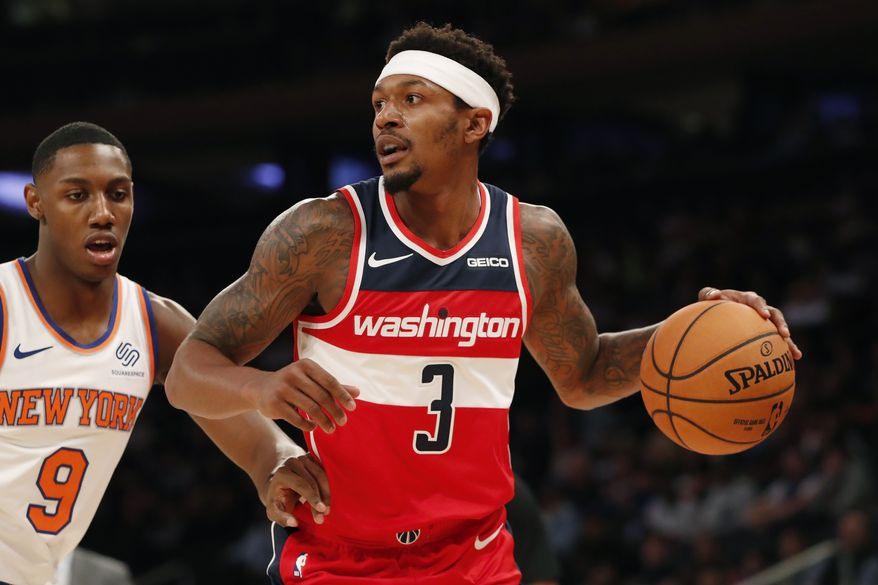 New York Knicks forward RJ Barrett (9) defends Washington Wizards guard Bradley Beal (3) during the first half of a preseason NBA basketball game in New York, Friday, Oct. 11, 2019. (AP Photo/Kathy Willens) ** FILE **
