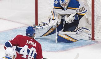 St. Louis Blues goaltender Jordan Binnington makes a save against Montreal Canadiens' Joel Armia during second period NHL hockey action in Montreal, Saturday, Oct. 12, 2019. (Graham Hughes/The Canadian Press via AP)