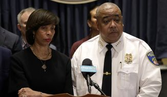 "IN this Feb. 11, 2019 photo, Baltimore Mayor Catherine Pugh, left, and Michael Harrison, center, acting commissioner of the Baltimore Police Department, listen to a reporter's question at an introductory news conference for Harrison in Baltimore. Police say a 2-year-old boy was wounded by gunfire when someone shot into a vehicle in an act of road rage, Saturday, Oct. 12.  Harrison says the boy is in ""somewhat stable condition"" and is expected to survive. (AP Photo/Patrick Semansky, File)"