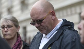 The father Harry Dunn, Tim Dunn, leaves the Foreign and Commonwealth Office in London, where the family members met British Foreign Secretary Dominic Raab, Wednesday Oct. 9, 2019.  19-year old Harry Dunn was killed in a road accident Aug. 27, thought to involve an American diplomat's wife who left the country under Diplomatic Immunity after reportedly becoming a suspect in the fatal crash. (Jonathan Brady/PA via AP)