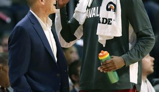 Cleveland Cavaliers head coach John Beilein, left, talks center Tristan Thompson during the first half of an NBA preseason basketball game against the Detroit Pistons, Friday, Oct. 11, 2019, in Detroit. (AP Photo/Duane Burleson)