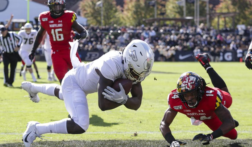 Purdue wide receiver David Bell (3) makes a catch for a touchdown over Maryland defensive back Deon Jones (14) during the first half of an NCAA college football game in West Lafayette, Ind., Saturday, Oct. 12, 2019. (AP Photo/Michael Conroy)